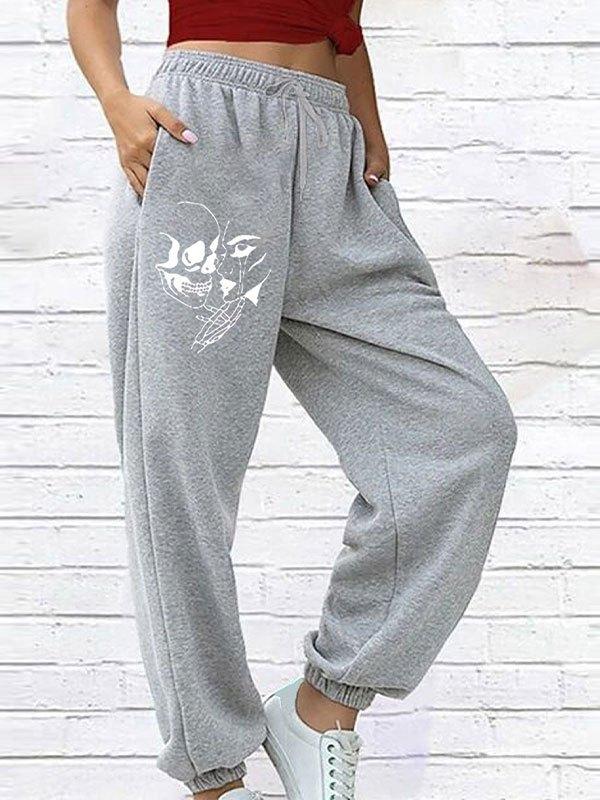 Pantaloni jogger con stampa facciale sul viso - Grigio S